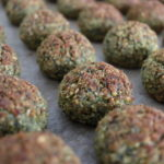 Backed falafel balls on a backing tray set in rows