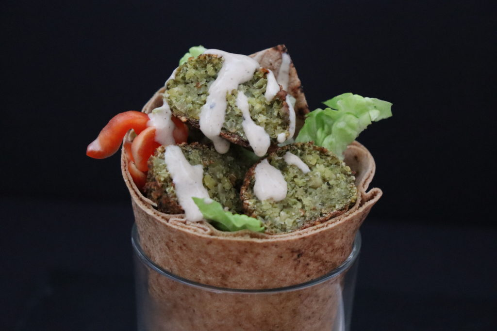 Falafel wrap with arabic flat bread, paprika, some green salad and tahini sauce