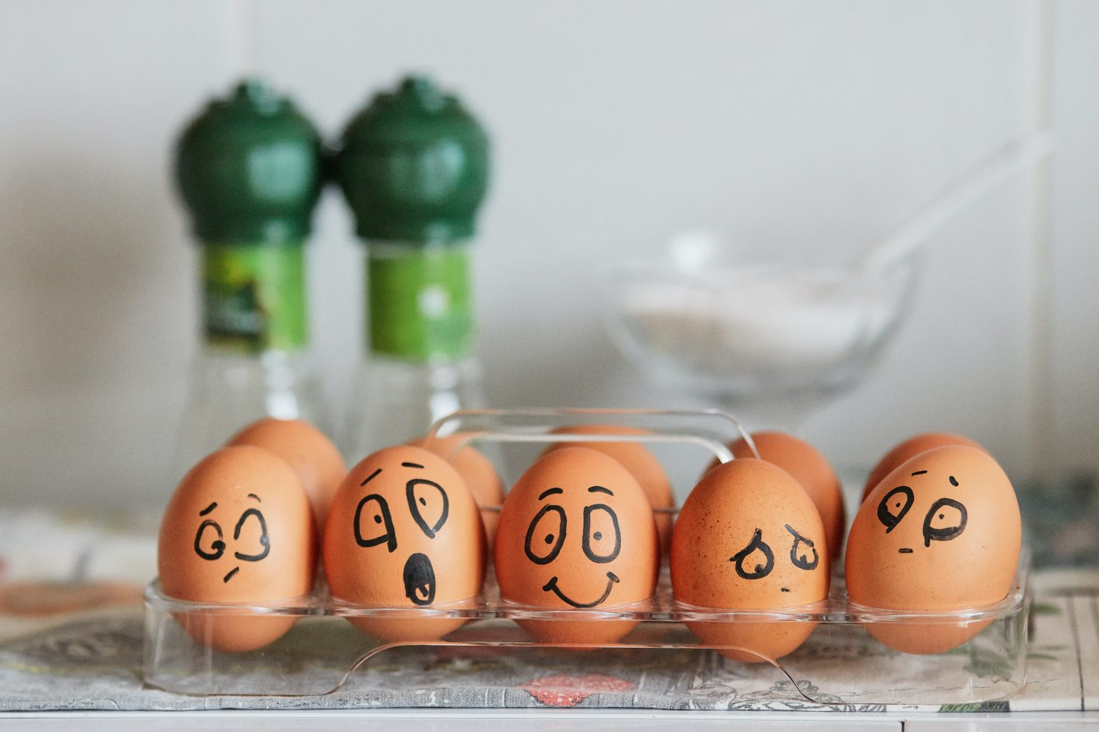 Eggs in a tray with painted faces
